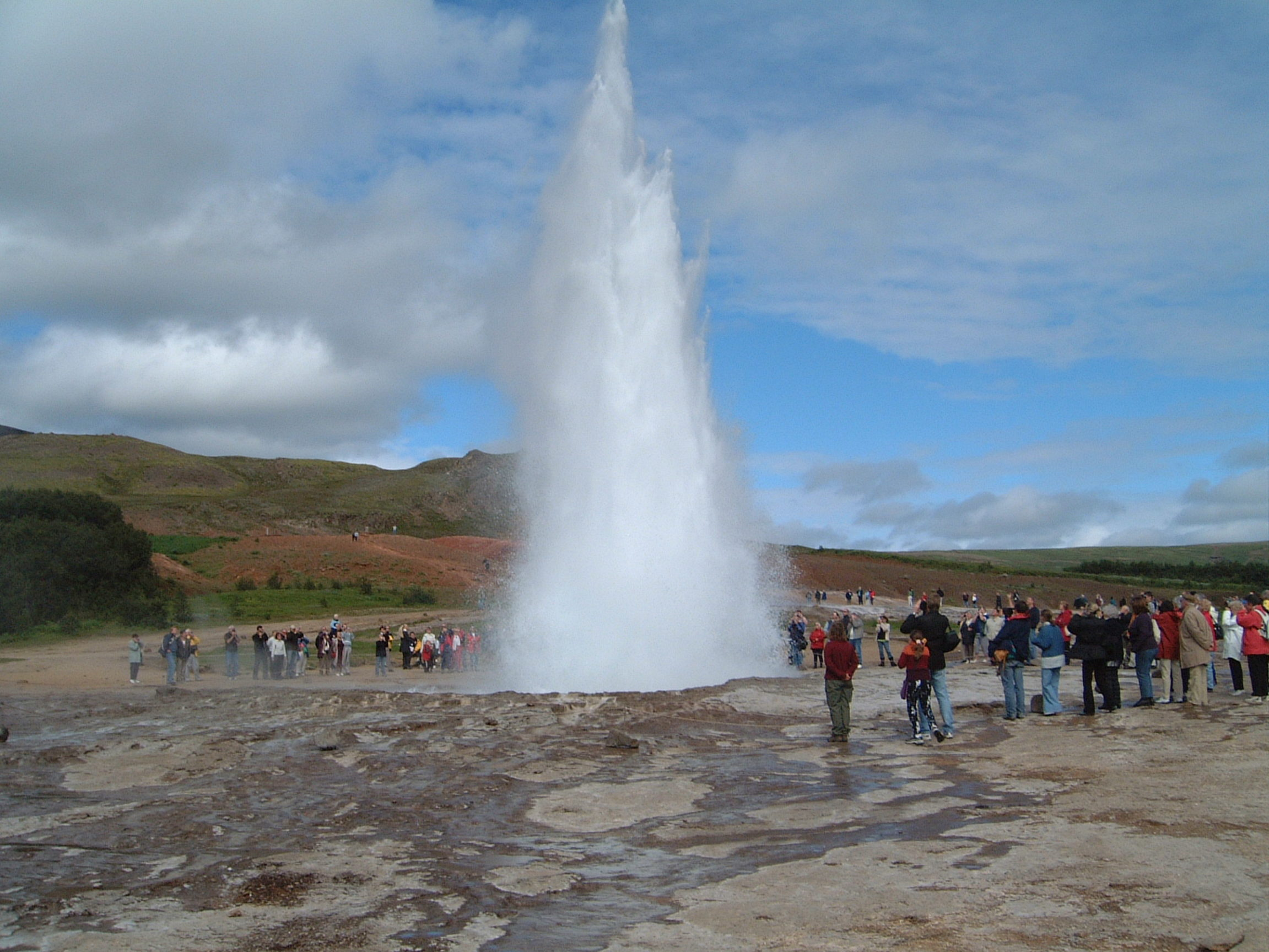 Strokkur in the Geysir field erupting.